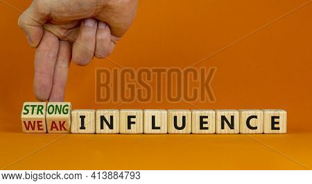 Weak Or Strong Influence Symbol. Businessman Turns Cubes And Changes Words 'weak Influence' To 'stro