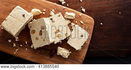 Halva Almond Nuts Slices On Wooden Table Background, Top View