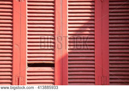 Wooden Closed Red Color Shutters For Background.