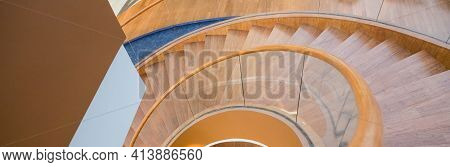 Wooden Stairs From House Interior.spiral Stairs In Modern Designer Building.a View Down A Stairway.w