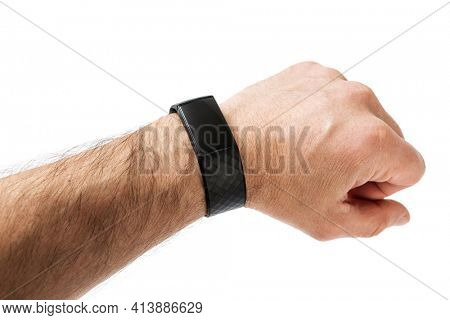 Hand with fitness activity tracker isolated on white background