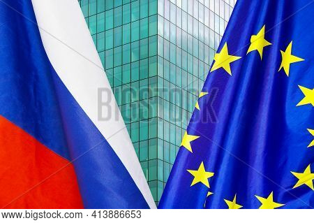 Flag Of Russia And European Union Flag Close-up. The Concept Of Political And Economic Relations Of