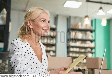Close Up Of Successful Mature Business Woman, Shop Owner Smiling, Using Her Laptop, Receiving Orders
