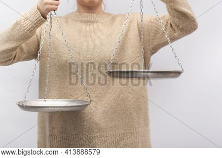 Man Is Holding The Scales. Equilibrium, Justice Concept