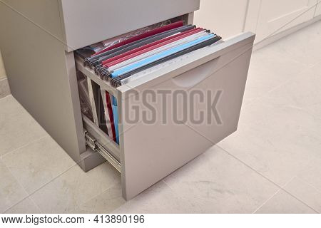 Open Metal Filing Cabinet With Documents, Folders, Subfolders, And Binders