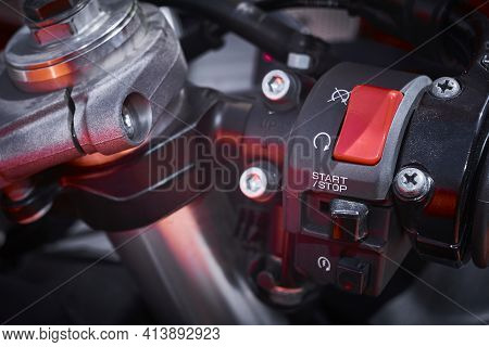 Ignition And Starting System Of A Sports Motorcycle Located On The Steering Handle And Safety Lock