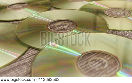 Bright Compact Discs With Colored Reflections Of A Disc Jockey At A Music Session