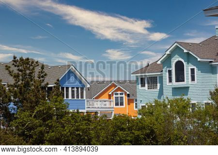 Colorful houses await visitors to Corolla on the Outer Banks of North Carolina.  This is a popular tourism destination.