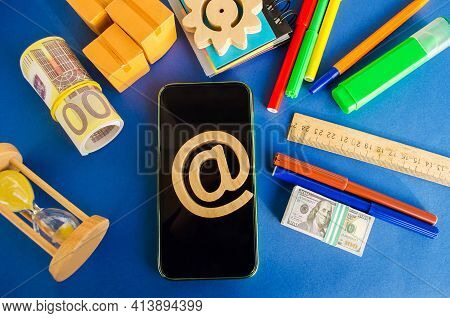 At Commercial Symbol On A Mobile Phone. Internet And Global Communication Technologies. Shopping Onl