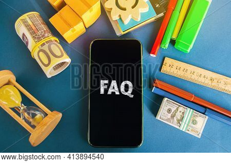 Mobile Phone With The Inscription Faq (frequently Asked Questions). Collection Of Frequently Asked Q