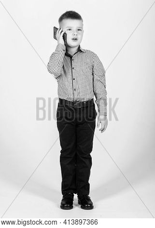 Small Businessman. Business School. Upbringing And Development. Little Boy Formal Clothes Call Mobil