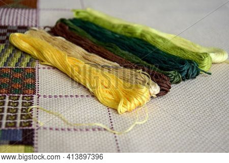 Fragment Of Colorful Cross-stitch Embroidered Picture With Mouline Threads. Unfinished Hand Embroide