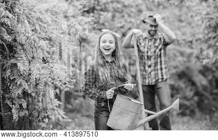 Family Dad And Daughter Planting Plants. Transplanting Vegetables From Nursery Gardening Center. Pla