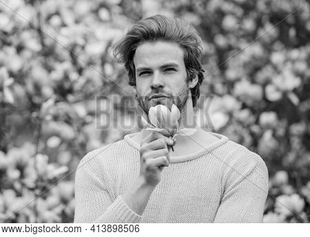 Hair Care And Beauty. Unshaven Man Magnolia Bloom. Beautiful Hairstyle. Man Flowers Background Defoc