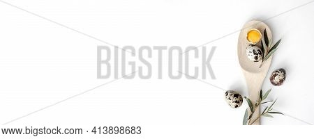 Quail Egg And Broken Egg With Egg Yolk On Wooden Spoon Isolated On White Background With Shadow. Fla