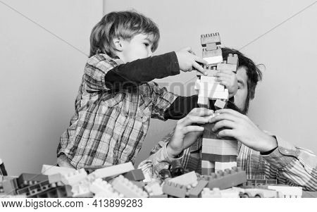 Dad And Son Have Fun. Childish Cheerful Dad And Funny Son. Dad Play Toys With Kid. Dad And Child Bui