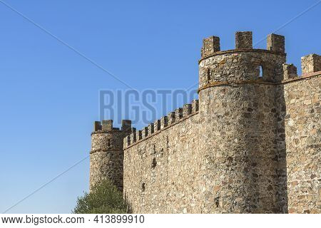 Battlements And Turrets Of A Medieval Castle On A Bluish Background