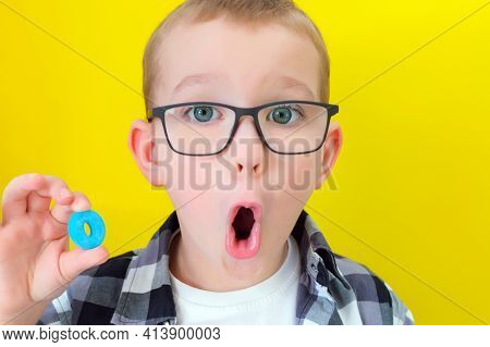 Speech Therapy. Toddler Boy Says The Letter O. Classes With A Speech Therapist. Boy On Isolated Yell