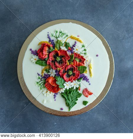 White Cream Cake Decorated With Buttercream Flowers, Poppies, Chamomile, Cornflowers, Spikelets Of W