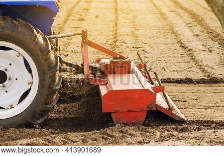 Tractor With Milling Machine Loosens, Grinds And Mixes Soil. Loosening The Surface, Cultivating The