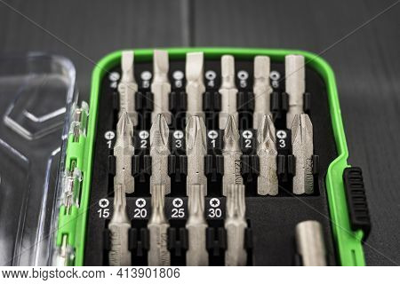 Toolbox With Many Interchangeable Screwdriver Tips In Gray Background