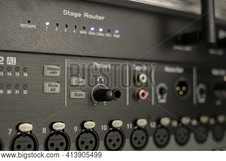 Set Of Audio Inputs On A Stage Mixer With Headphone Output, Phantom Power Buttons And Stage Router S