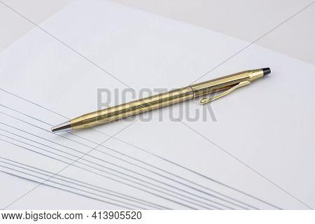 Golden And Shinny Pen On White Envelope Set