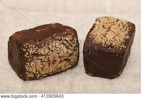 Rye Bread. Dessert Rye Bread With Raisins And Walnuts In Sourdough, Sprinkled With Sesame Seeds. Hom