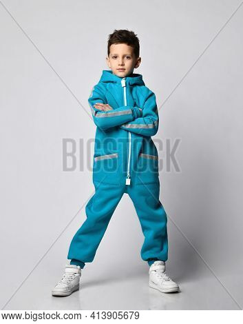 Fashion Boy Child In Warm Sportswear Suit Standing With Crossed Hand On Chest. Male Kid Advertising