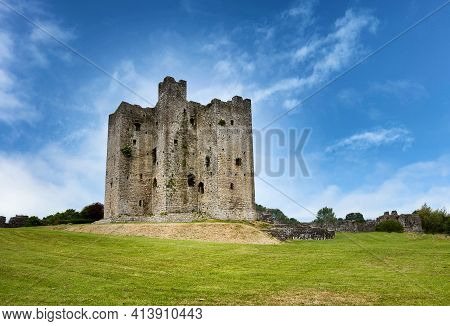 Ancient Mediaeval Castle In Ireland Surrounded By Grassy Green Fields