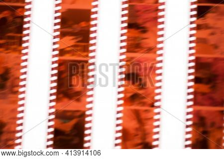 35mm film with motion blur on a white background