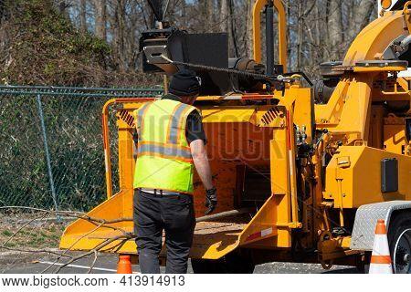 Wood Chipper Machine Releasing The Shredded Woods Worker