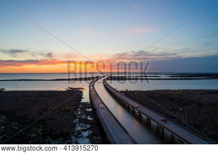 Sunset Over Mobile Bay, Alabama And Interstate 10 Bridge