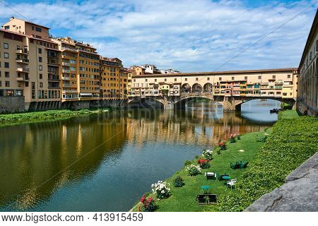 Horizontal View Of Ponte Vecchio And Picturesque Buildings On A Beautiful Sunny Spring Day With Blue
