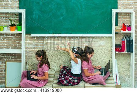 Modern Education. Adorable Students Study Together. Homeschooling Concept. Kids With Laptops And Vr