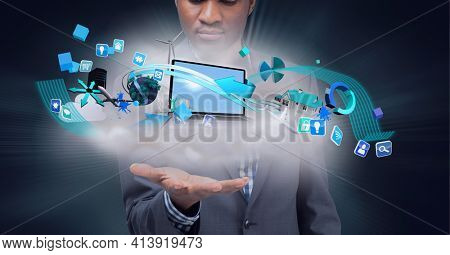 Composition of network of digital icons with laptop and wind turbine over hand of businessman. global technology and digital interface concept digitally generated image.