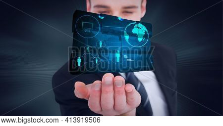 Composition of network of digital icons with globe on digital screen over hand of businessman. global technology and digital interface concept digitally generated image.
