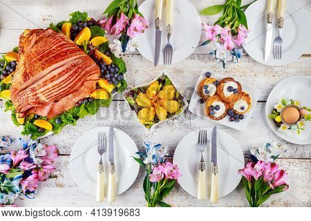 Table Setting With Baked Pork Ham On Easter Table. Holiday Concept.