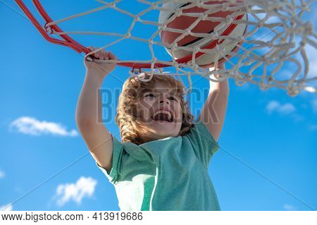 Basketball Kid Player Running Up And Dunking The Ball.