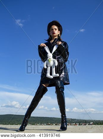 Sexy Woman. Gorgeous Woman Dressed Black Clothes And Boots. Beautiful Girl Demonstrating Stylish Clo