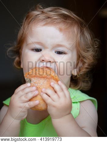 Cute Baby Boy Is Very Greedy Eating A Piece Of White Bread, Hungry And Happy