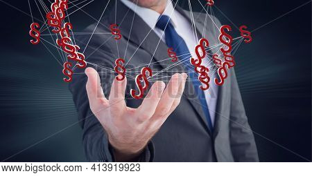 Composition of network of digital legal paragraph icons over hand of male lawyer or businessman. global technology and digital interface concept digitally generated image.