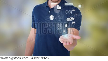 Composition of network of digital icons and statistics over hand of businessman. global technology and digital interface concept digitally generated image.