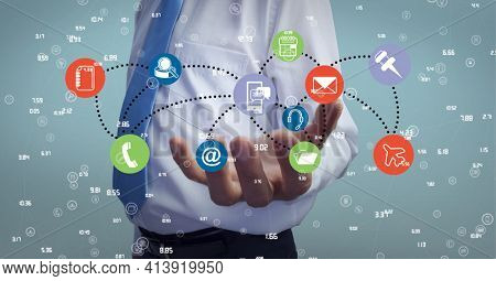 Composition of network of digital icons with numbers processing over hand of businessman. global technology and digital interface concept digitally generated image.