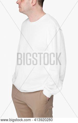 Man wearing white sweater close-up