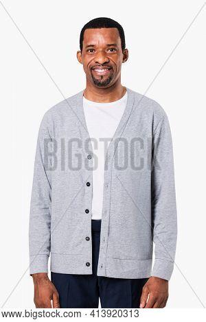 African American man wearing gray cardigan