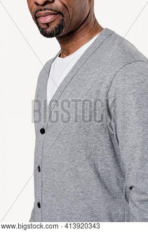 African American man wearing gray cardigan close-up