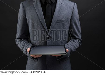 Businessman holding his tablet with both hands