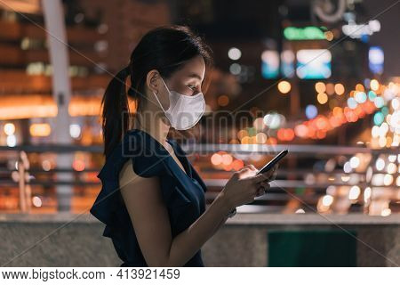 Side-view Of Beautiful Young Asian Happy Woman Wearing Covid-19 Face Mask Standing Over Footbridge C