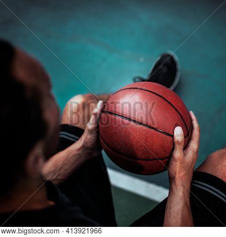 Man holding his favorite basketball